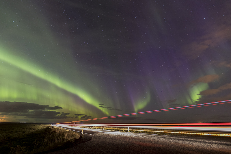 A bus passing through the Aurora