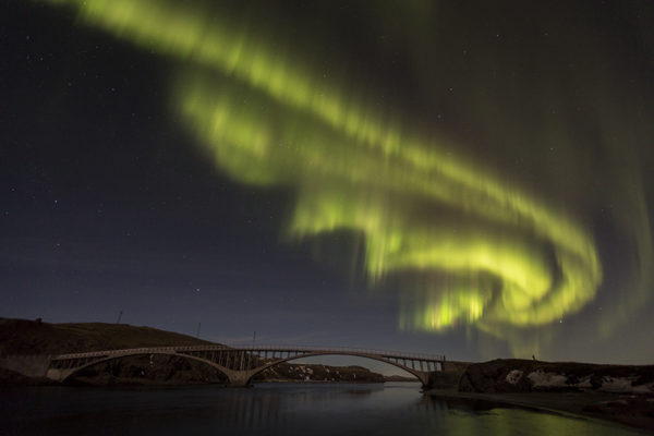 Aurora at the old bridge in Borgarfjordur