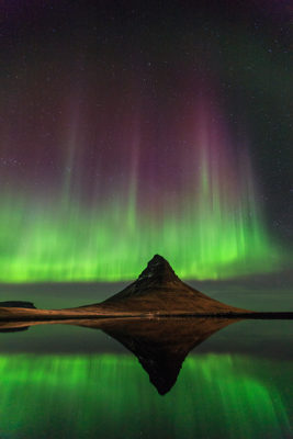Aurora reflection at mountain Kirkjufell