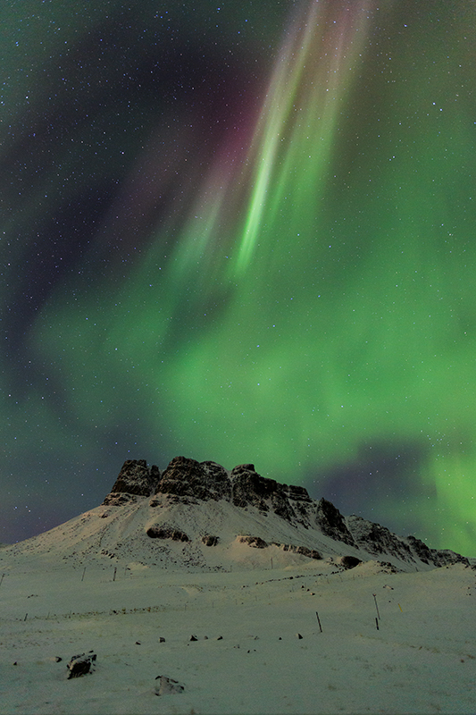 Mountain Thyrill and Aurora in Hvalfjordur
