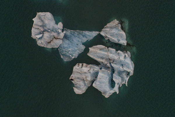 Icebergs at glacier lagoon from above