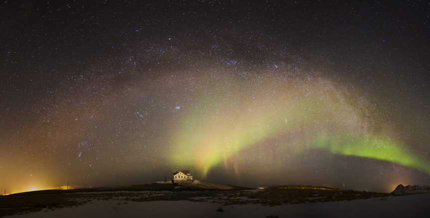 panorama of Milky way and Aurora at Fiskilækur in Hvalfjordur