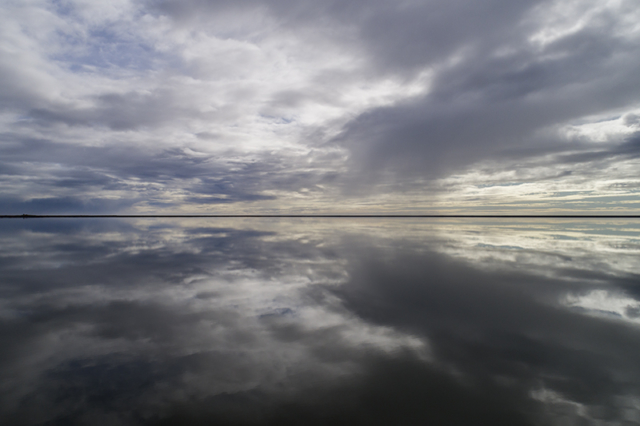 Thin line seperating sky and lake in a perfect reflection