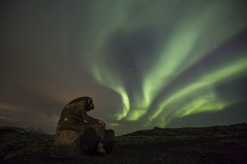 Statue of Grýla with Northern lights