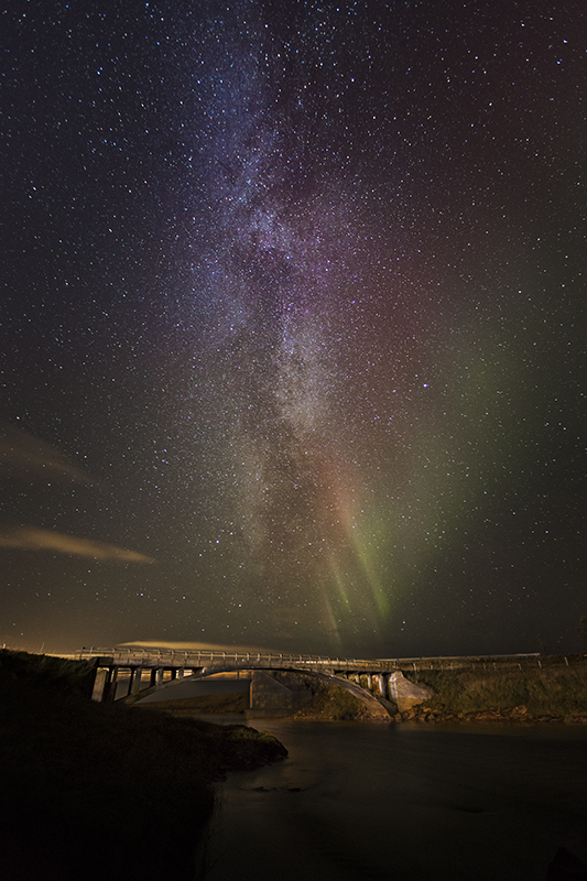 Old and rusty bridge with milky way