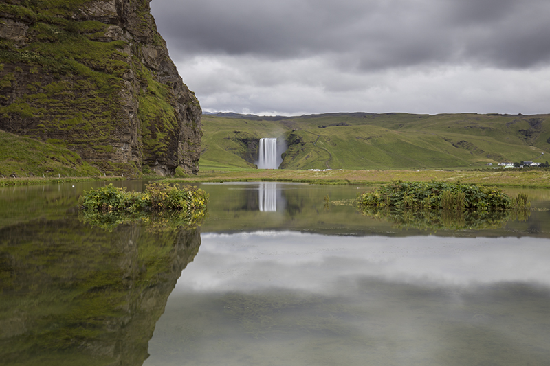 Skógafoss and its reflection