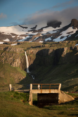 Waterfall with old bridge in the foreground