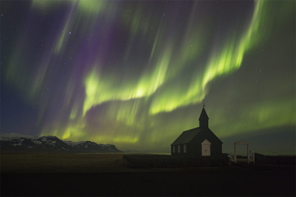 Aurora at the black church at Budir