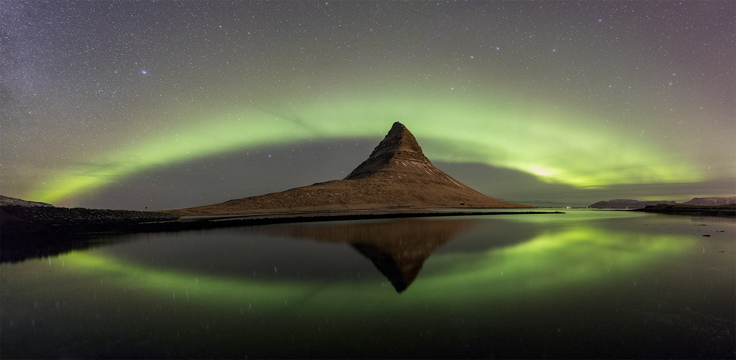 Kirkjufell in aurora pano at Snaefellsnes peninsula