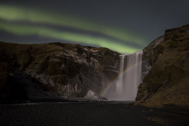 The waterfall Skogafoss with moonbow
